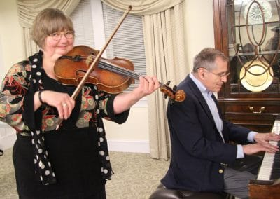 Betty Hauck on viola and Villager Frank Bunn on piano during a presentation, A Life in Music Lost and Found.