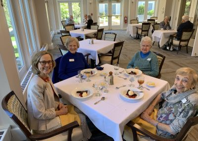 picture of four women, dining room, birthday desserts, Anne Doyle